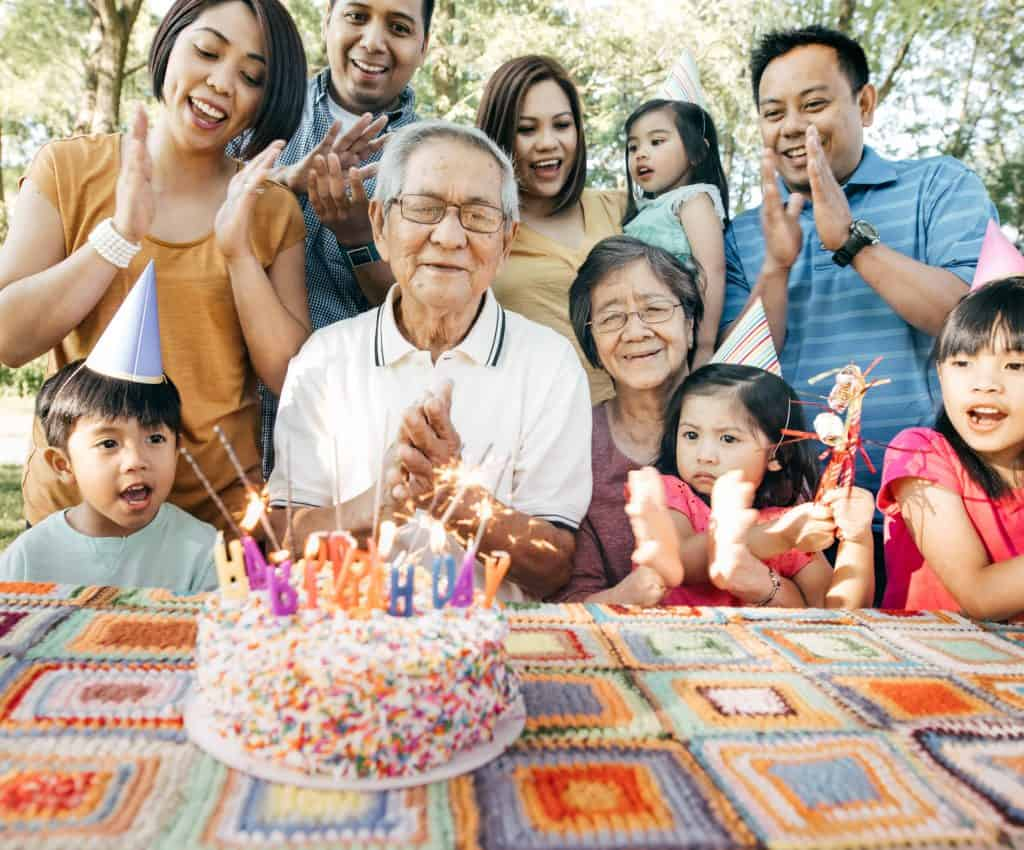 Asian grandfather with birthday cake