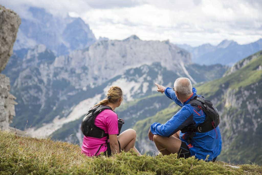 Hikers sitting on top of mountain