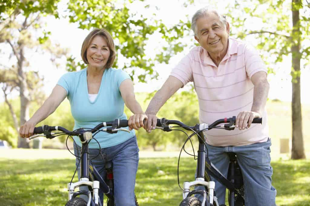 Hispanic couple on bikes