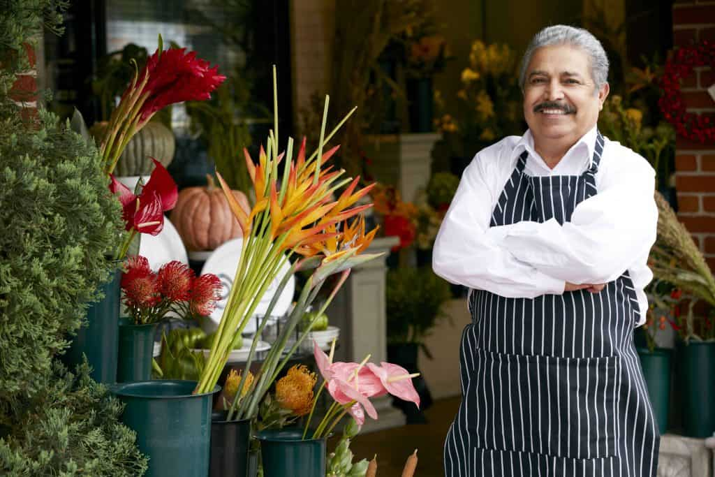 Hispanic florist outside shop