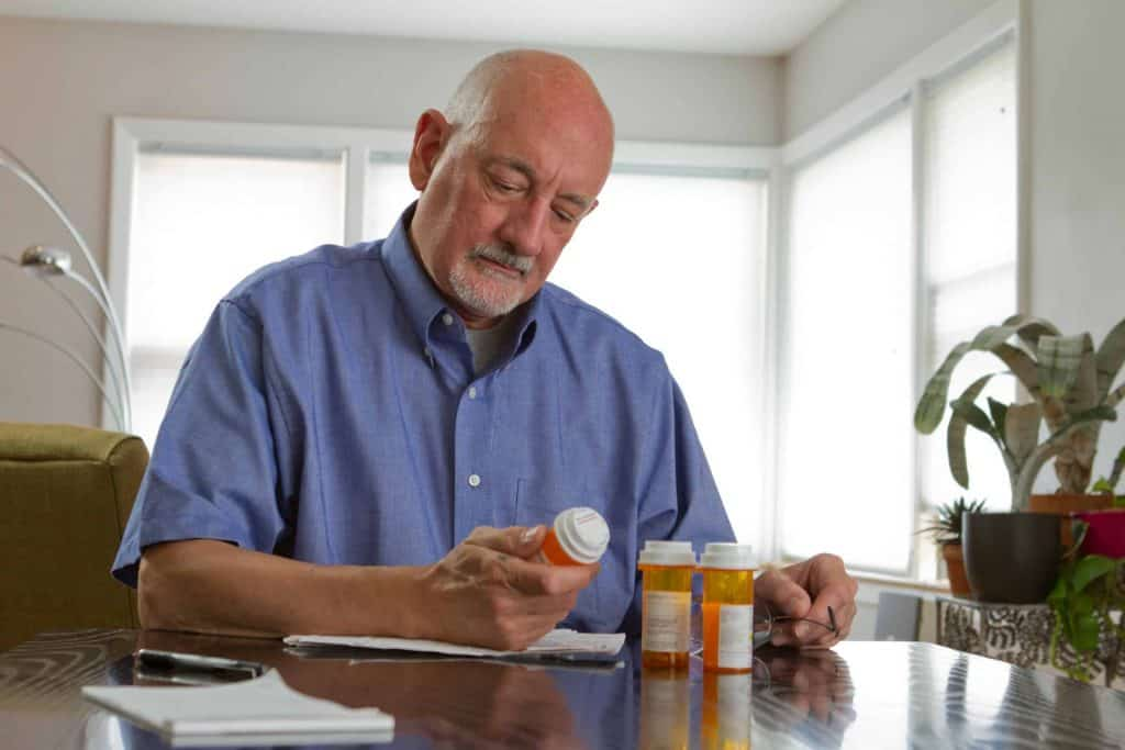 Senior looking at prescription drugs