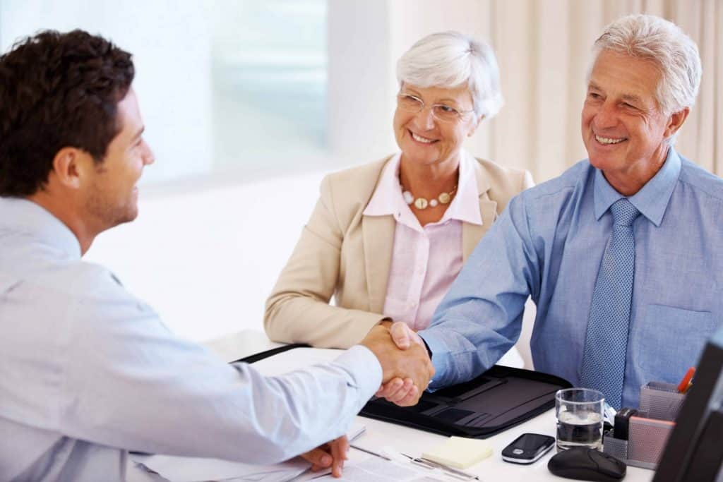 Senior couple meeting with Medicare broker