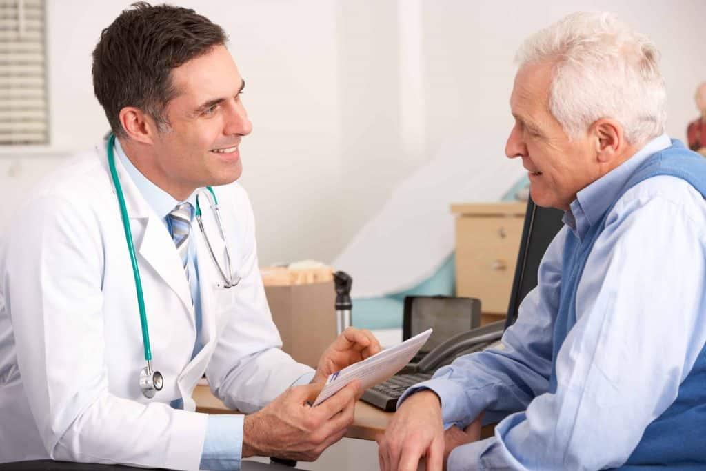 senior talking to medical doctor