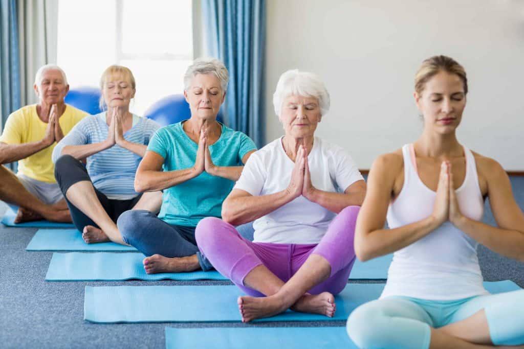 Seniors in yoga class