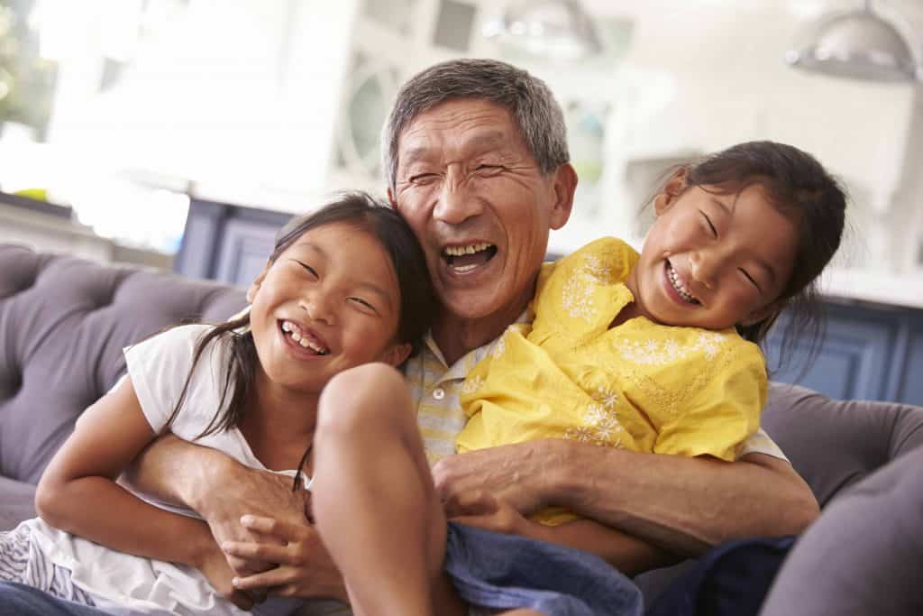 Asian grandfather and granddaughters